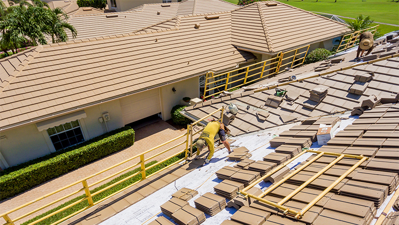 Perfect Man On Roof Completing Tile Roofing Services | Gulf Coast Roofing | Naples,  Florida
